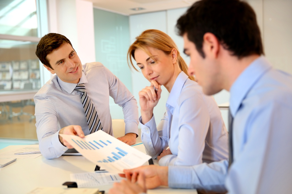 Sales director presenting business plan to team.jpeg